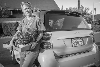 "Margaux Singleton, owner of Enotea Wine Shop, picks up flowers at the ACE Hardware in Calistoga, CA  ""These plants are to replace a few that have died.""  mx@mxwines.com"