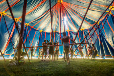 In an otherworldly environment, Flynn Creek Circus performers and crew raise the tent in advance of performances in Calistoga.