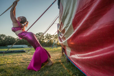 Mermaid Nichol Laumb stretches prior to her performance with the Flynn Creek Circus in Calistoga.