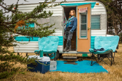 """We call this the toaster.""  -Jen Snyder stands in the door of her mobile home with the Flynn Creek Circus at Point Arena, CA."
